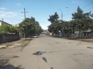 Земельный участок в Батуми. На участке есть хозпостройки. Фото 1