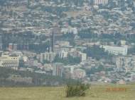 Участок в Тбилиси с видом на горы и город. Купить земельный участок в пригороде Тбилиси, Шиндиси. Фото 1
