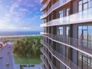 Комфортабельные апартаменты у моря в жилом комплексе Батуми. Жилой комплекс гостиничного типа на Новом бульваре в Батуми, Грузия.  Фото 4